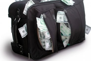 suitcase stuffed with money