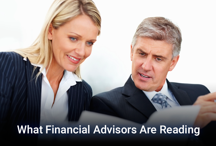 female and male financial advisors reading