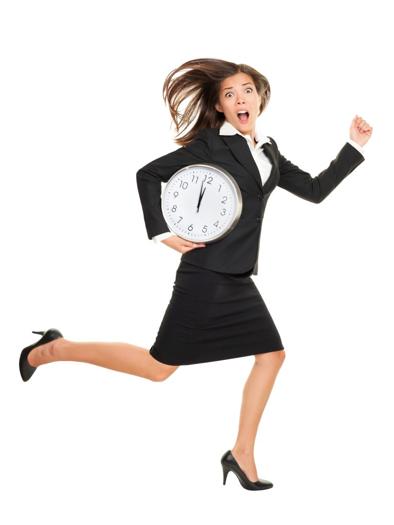 business woman running with clock