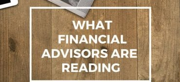 table with computer, newspaper and coffee and headline what financial advisors are reading