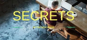 Man on his computer with Secrets of the Self-made headline