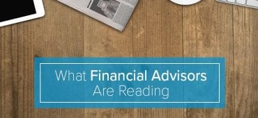 Desk with headline What Financial Advisors Are Reading