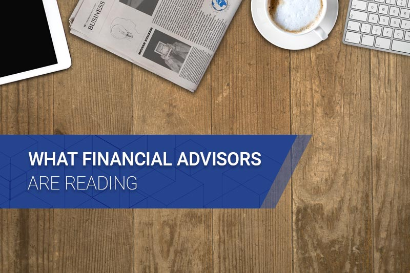 What financial advisors are reading with wood table and newspaper