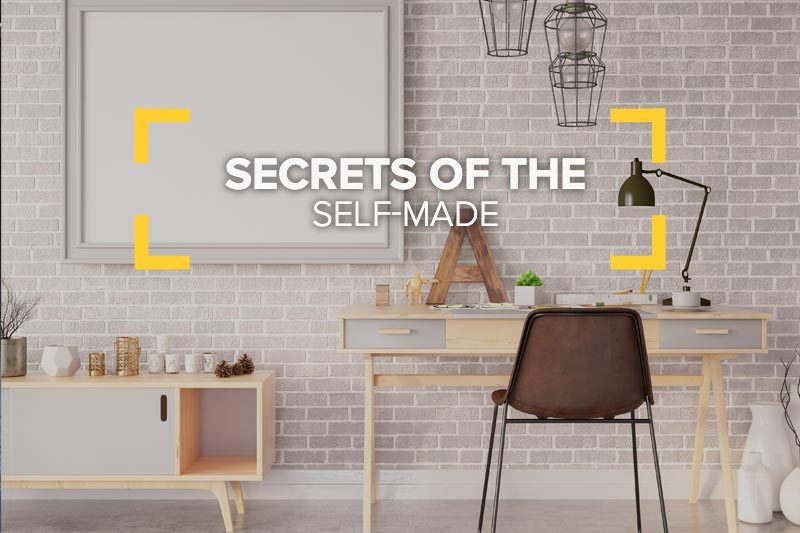 Interior of home with desk and chair with Secrets of the Self-made headline