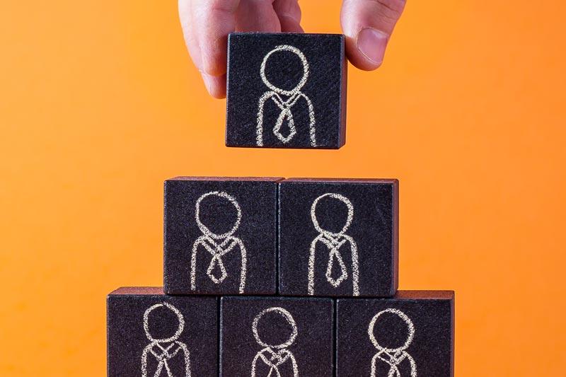 Black blocks with men in neckties