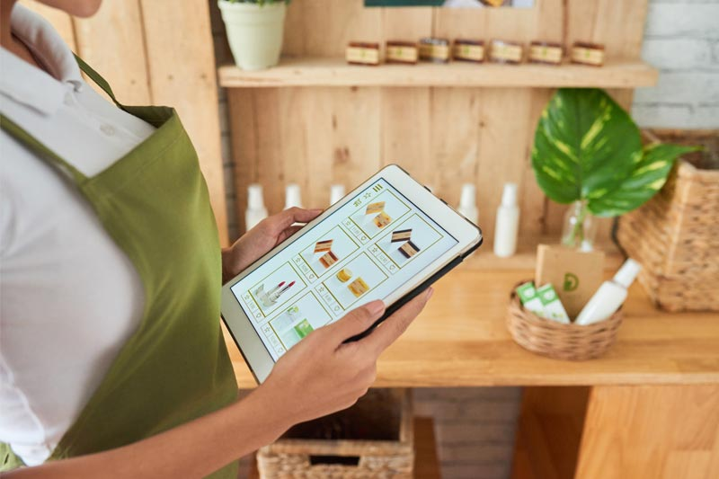 Business woman looking at merchandise on tablet