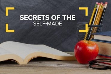Open book with apple and pencils
