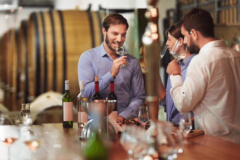 People drinking wine at a winery