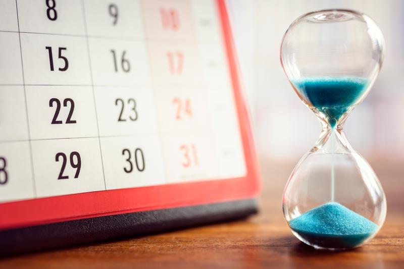 Sand timer next to calendar