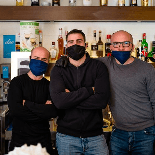 3 business partners wearing masks