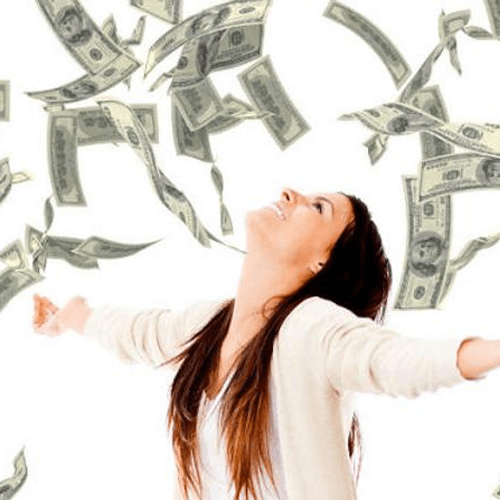 Woman standing under money raining