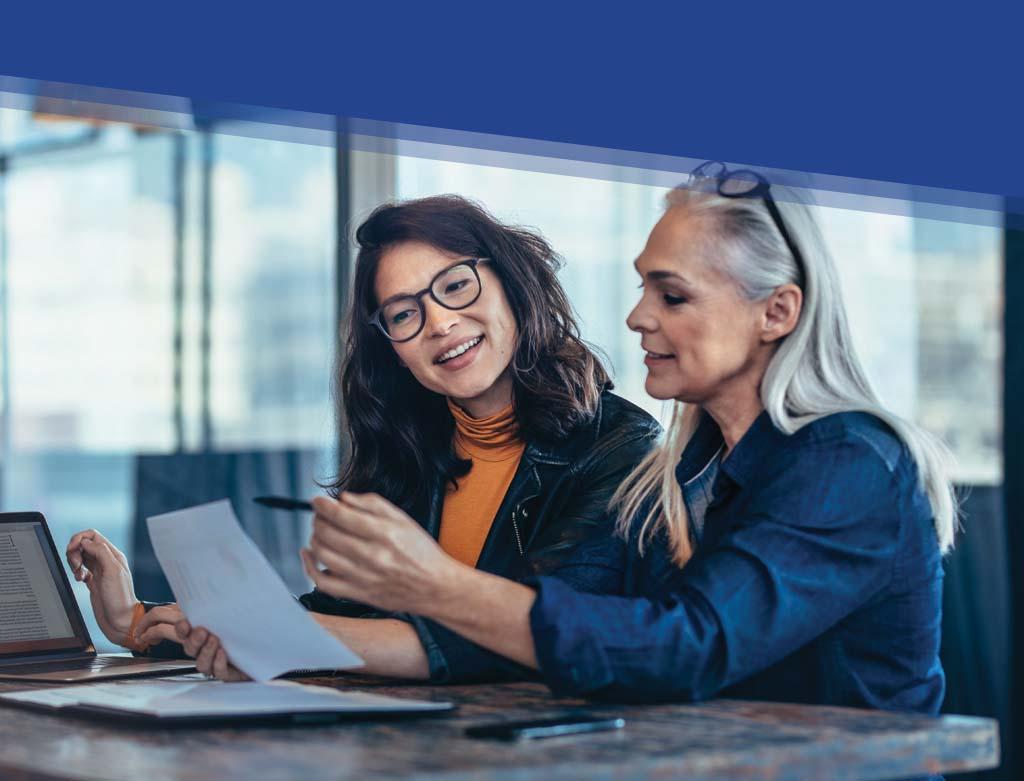 Tablet Slide of Two Women Investing